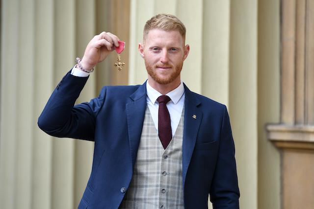 Ben Stokes holding his OBE