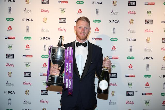Ben Stokes holding trophies