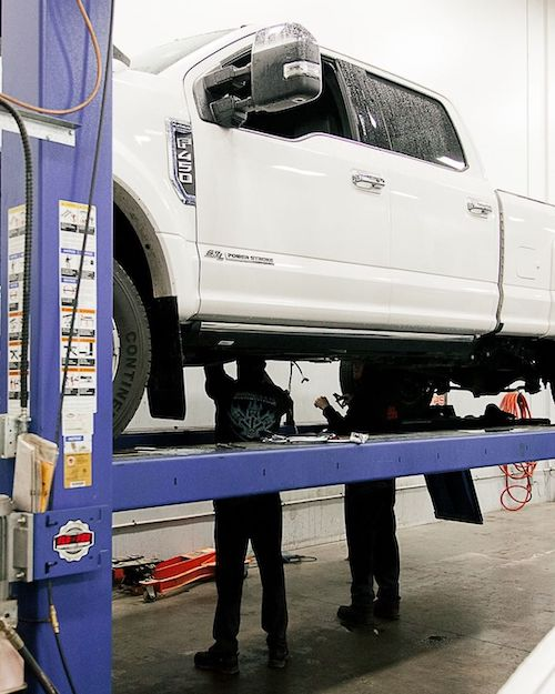 Ford F-450 on the lift getting oil change serviced