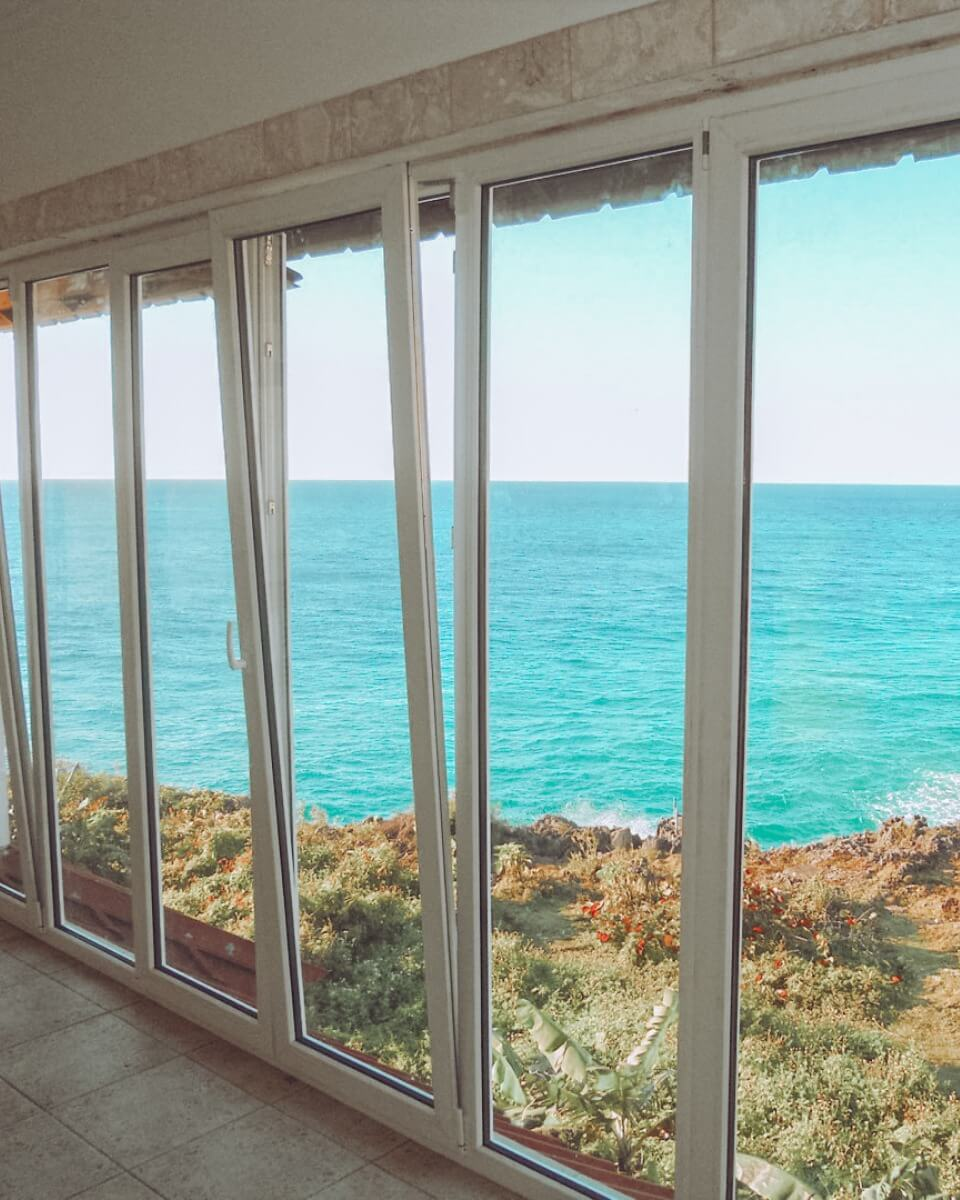 Tilt and turn doors with views over the ocean.