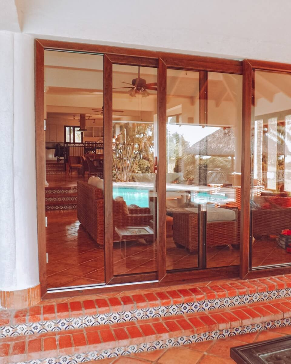 Entrance into a house with brown sliding doors