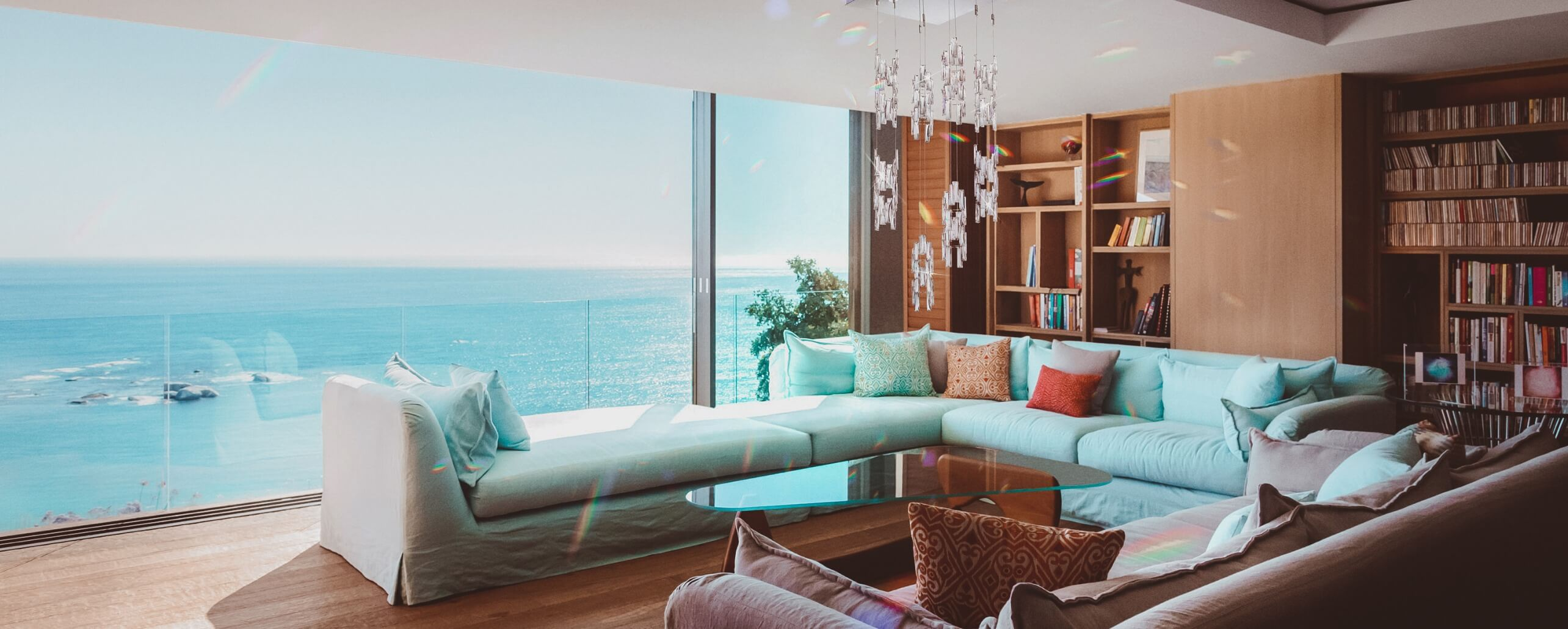 A view over the ocean from a living room. Full Width.