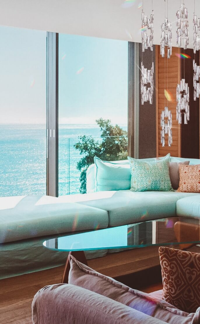 A view over the ocean from a living room.