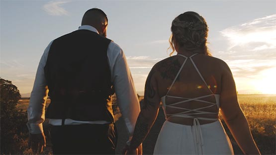 Husband and Wife walking into the sunset