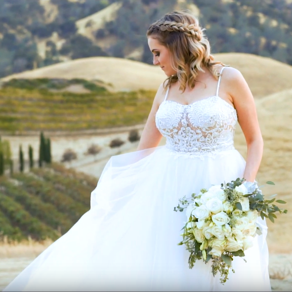 Bride holding her dress in the wind