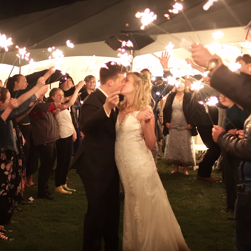 Bride and Groom Holding Sparklers at wedding