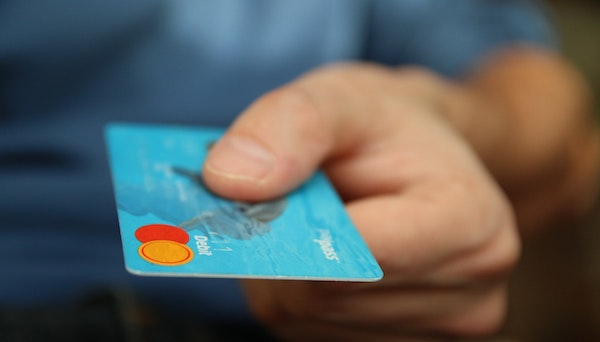 a person using a credit card