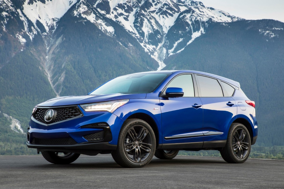Blue acura rdx in mountains