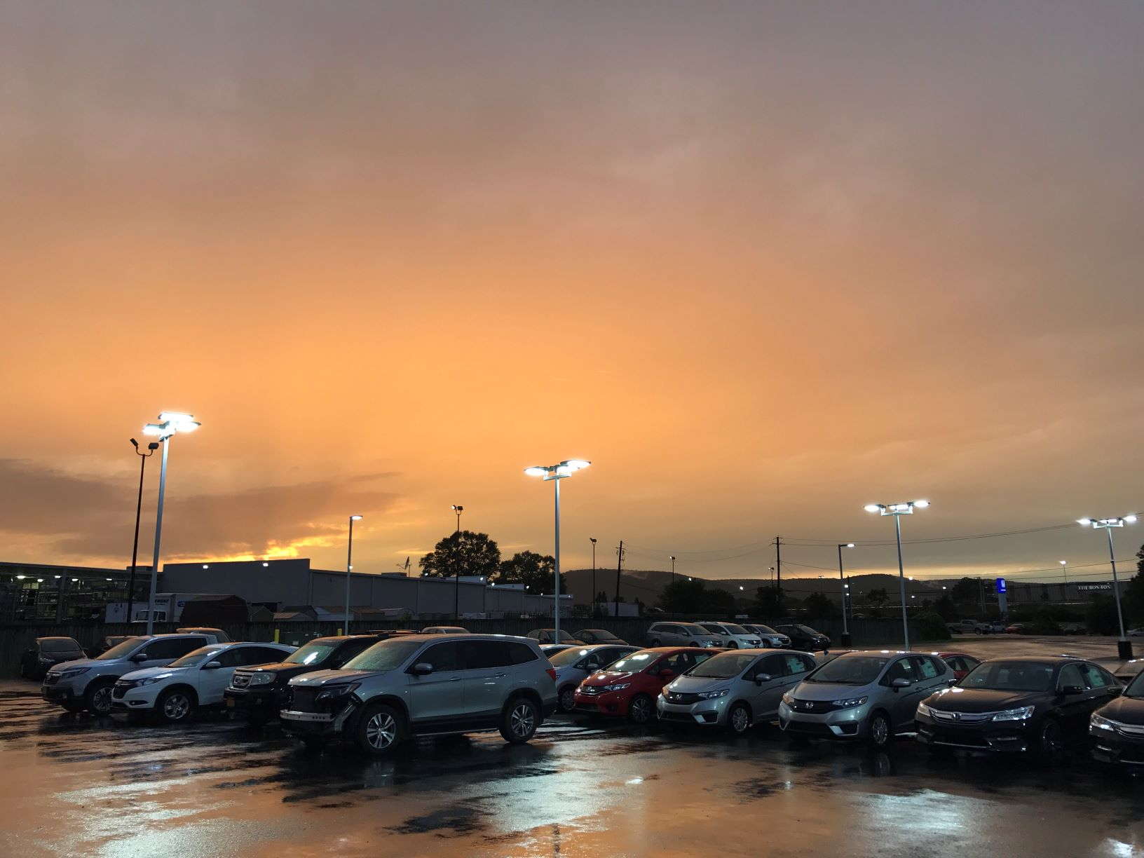 car dealership at sunset
