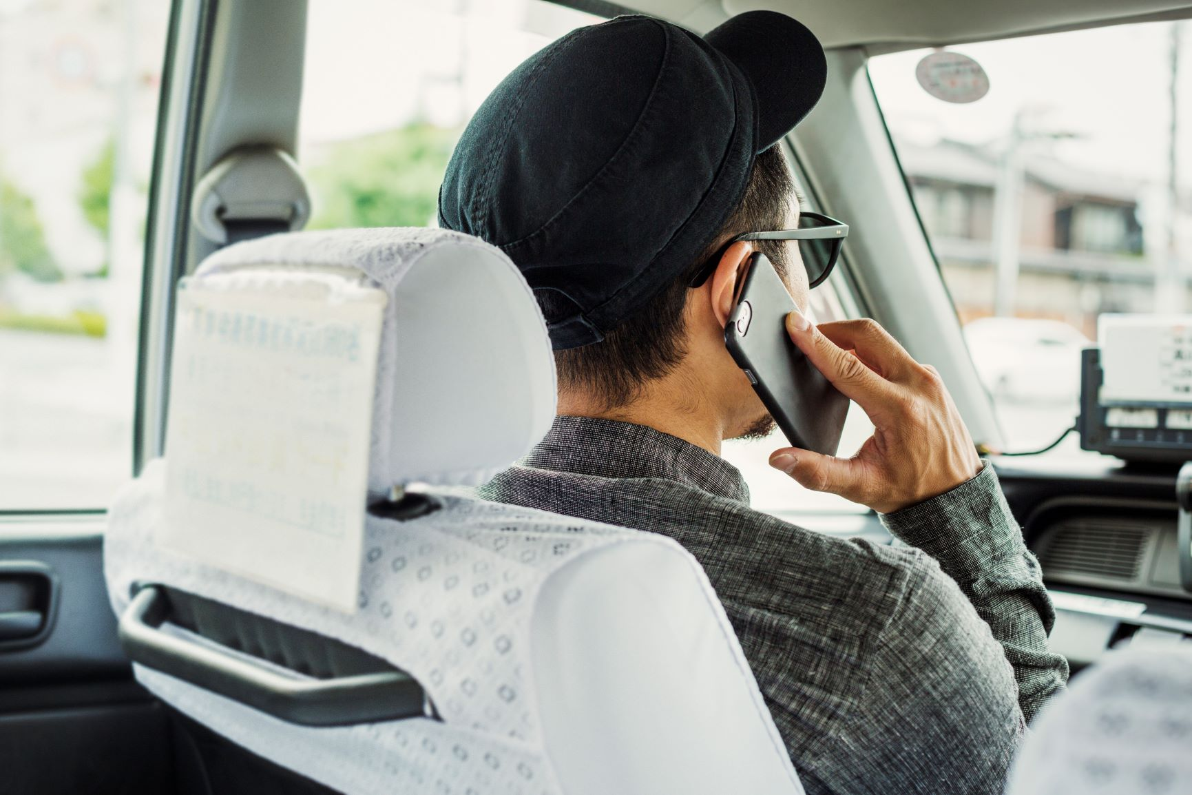 man on a phone call while driving