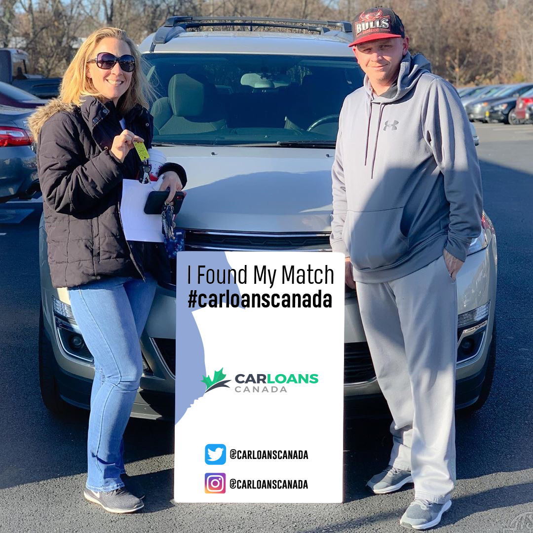 Couple standing in front of car from car loans canada