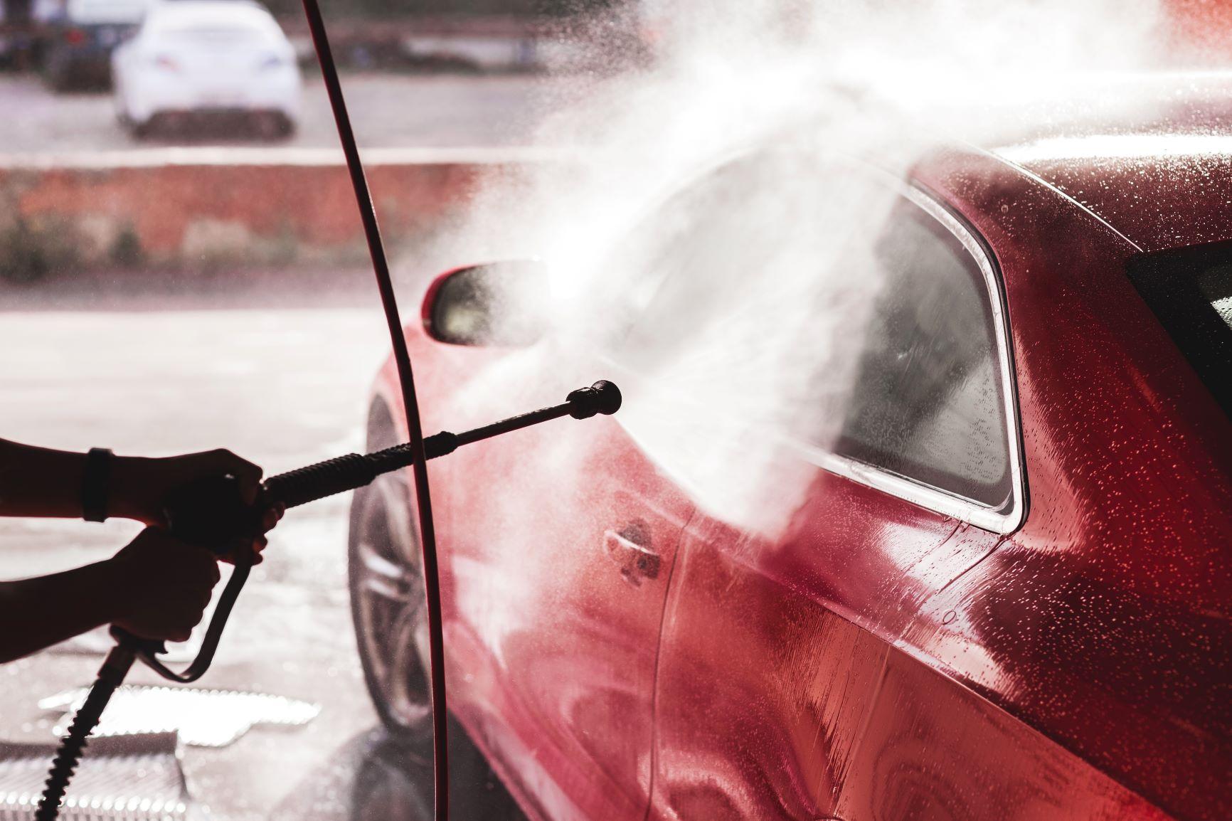 car washing a red sports car