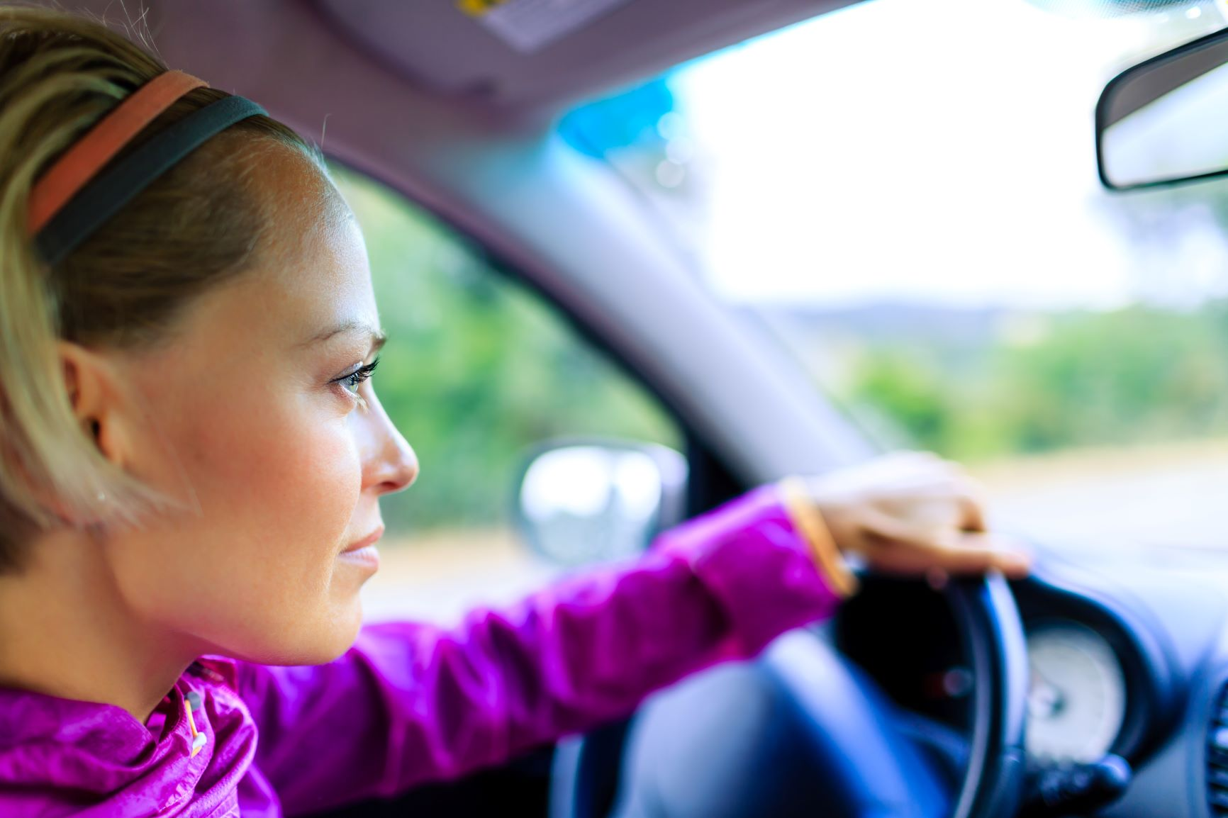 blonde woman driving her car