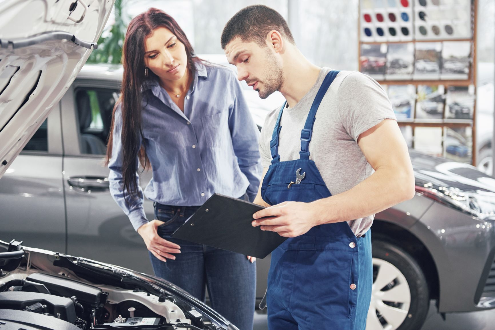 car mechanic with female customer
