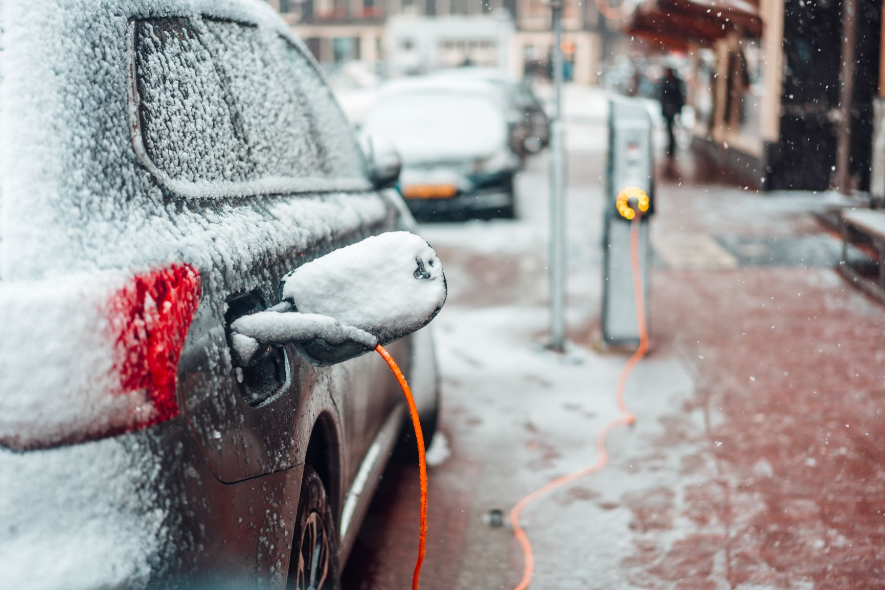 electric car plugged in winter