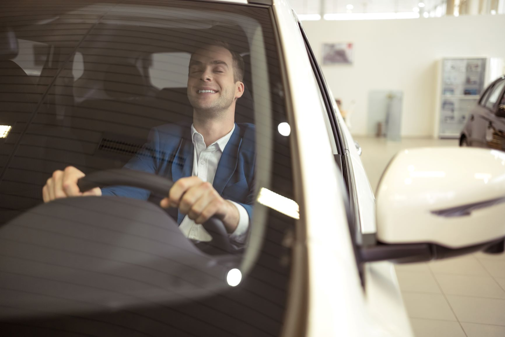 man sitting in driver seat of a car