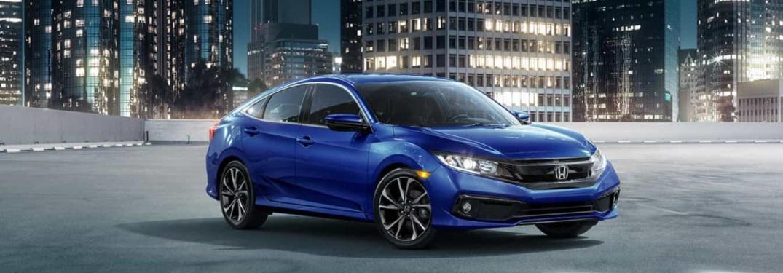 Blue Honda Civic in the city