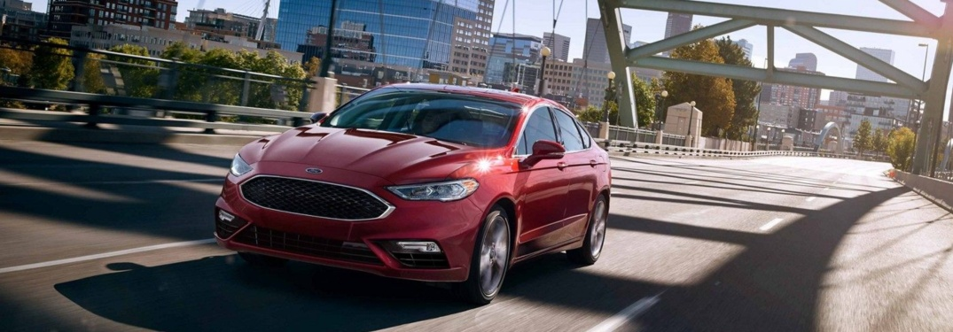 Red ford fusion driving under bridge