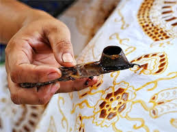 Traditional Batik tool being used to make new fabric.