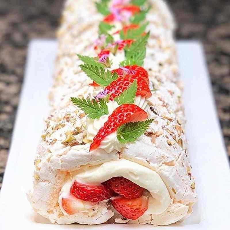 Pistachio and Strawberry Meringue Roulade with Elderflower Cream