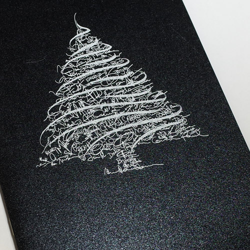 White ink printed onto a black Pearl card