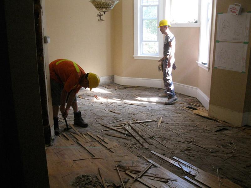 Design & Renovate Project: Main Floor Renovation - Construction Workers Working on Flooring