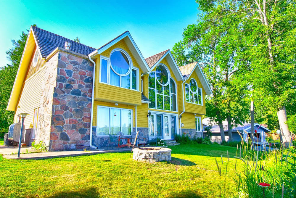Design & Build Project: Young's Point - Yellow Home WIth Stone Work