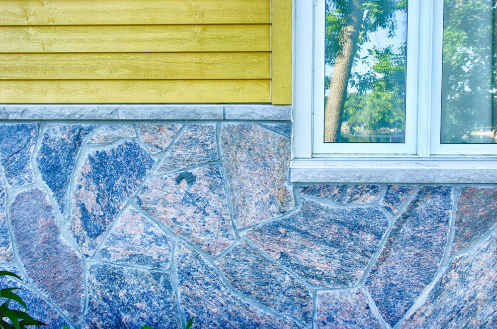 Design & Build Project: Young's Point - Yellow Home With Stone Skirting