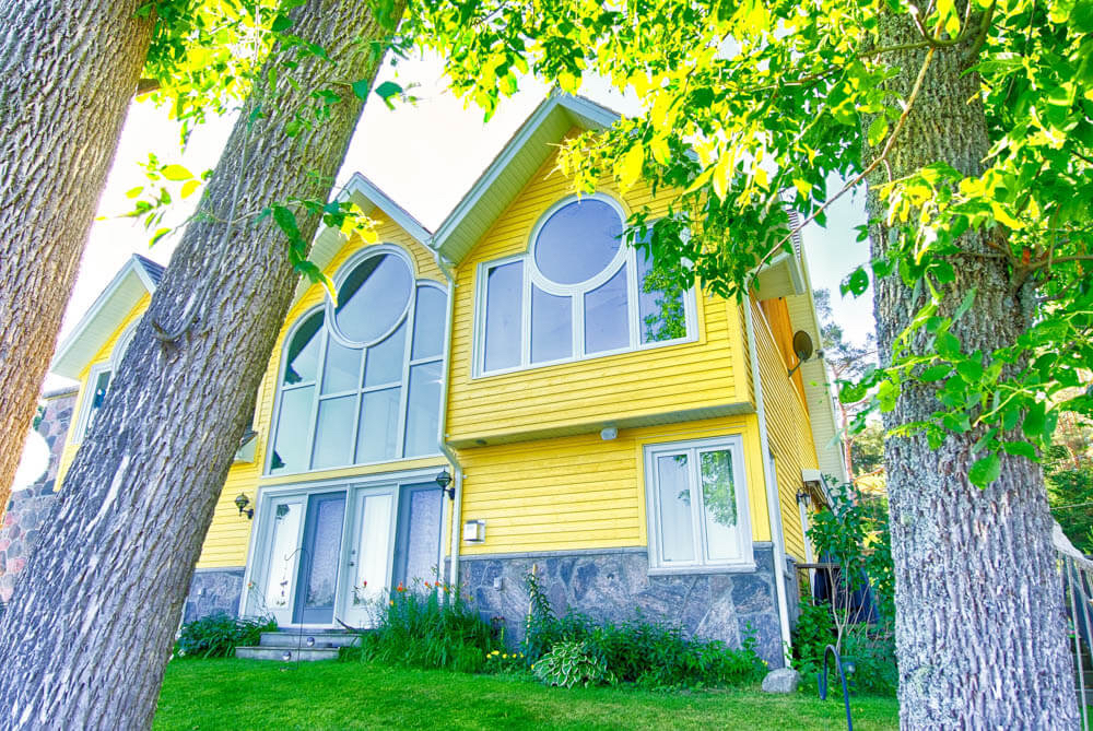 Design & Build Project: Young's Point - Yellow Home With Trees