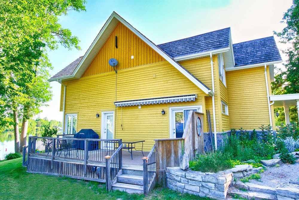 Design & Build Project: Young's Point - Yellow Home Side View