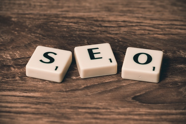 What is the distinction between natural and paid search results?