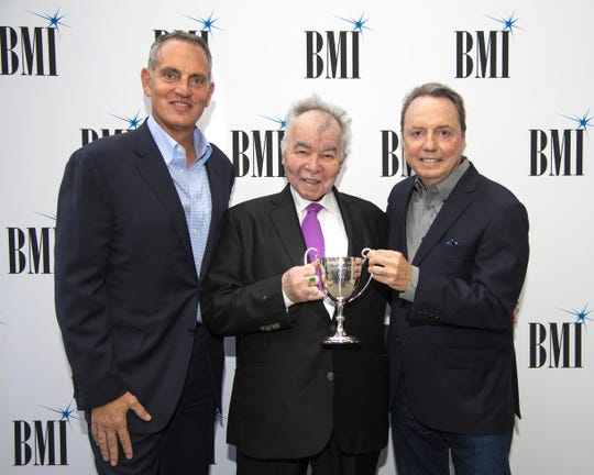BMI's Mike O'Neill, Troubadour Award recipient John Prine and BMI's Jody Williams gather for a photo at the BMI Nashville office on Sept. 10, 2018.