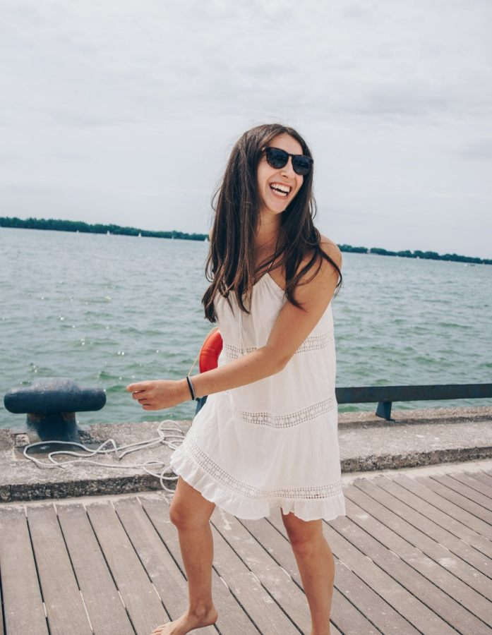 woman smiling walking on the pier