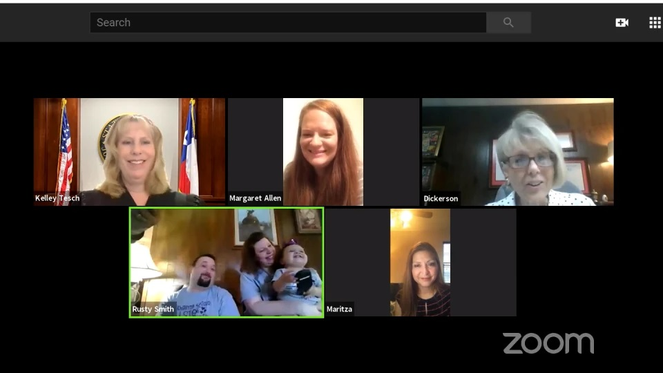Am image of a judge, an attorney, and families communicating on zoom