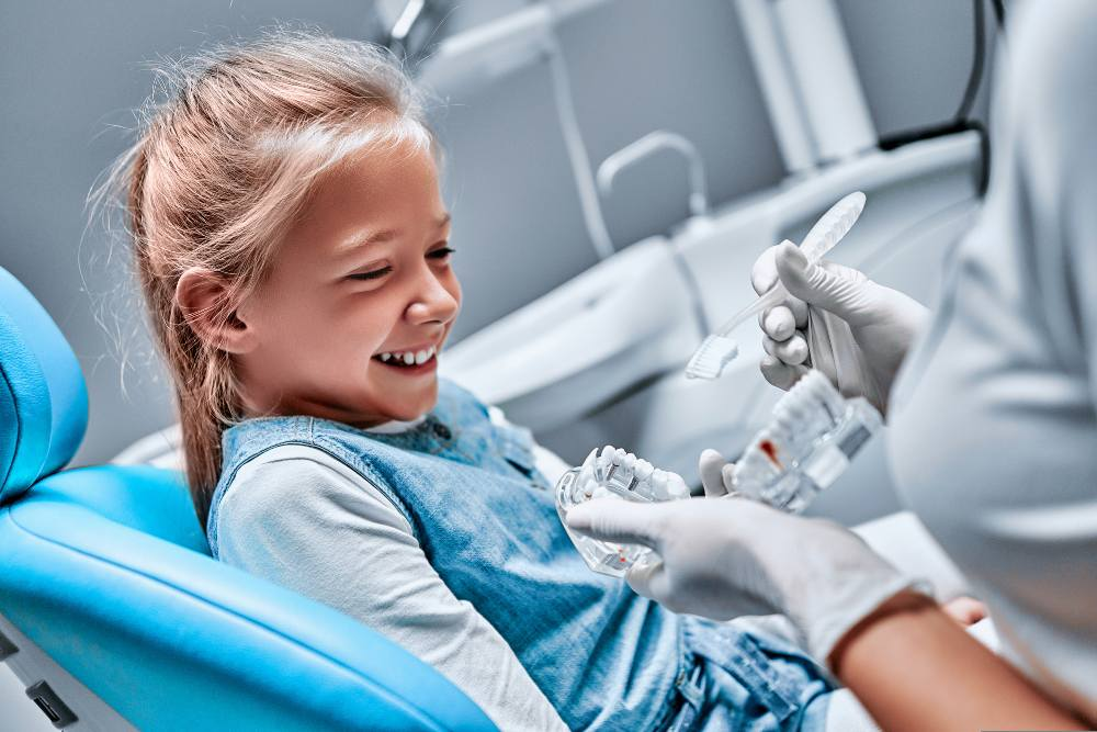 little girl getting teeth checked