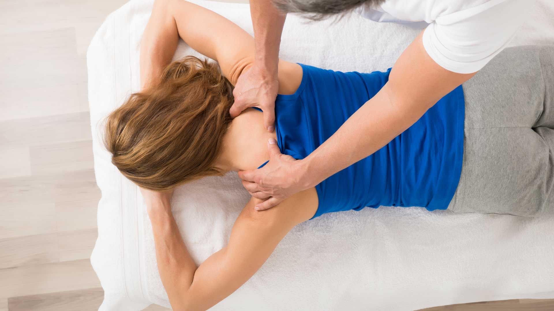 A woman on a massage table receiving a therapy