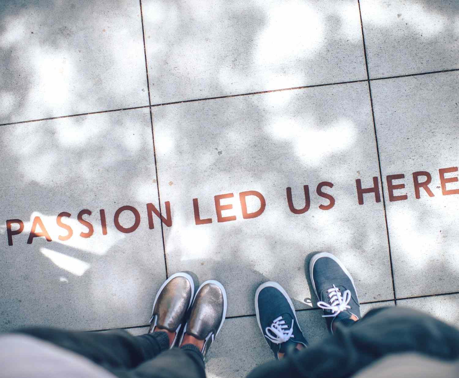 """Image of sidewalk with words """"Passion led us here"""""""