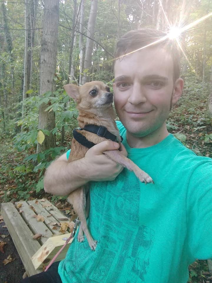 Daniel Wallen holding a chihuahua.