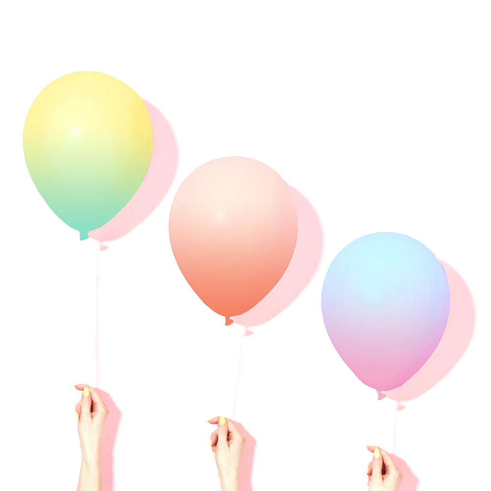The balloons at increasing heights colored like the Cantrip can flavors.