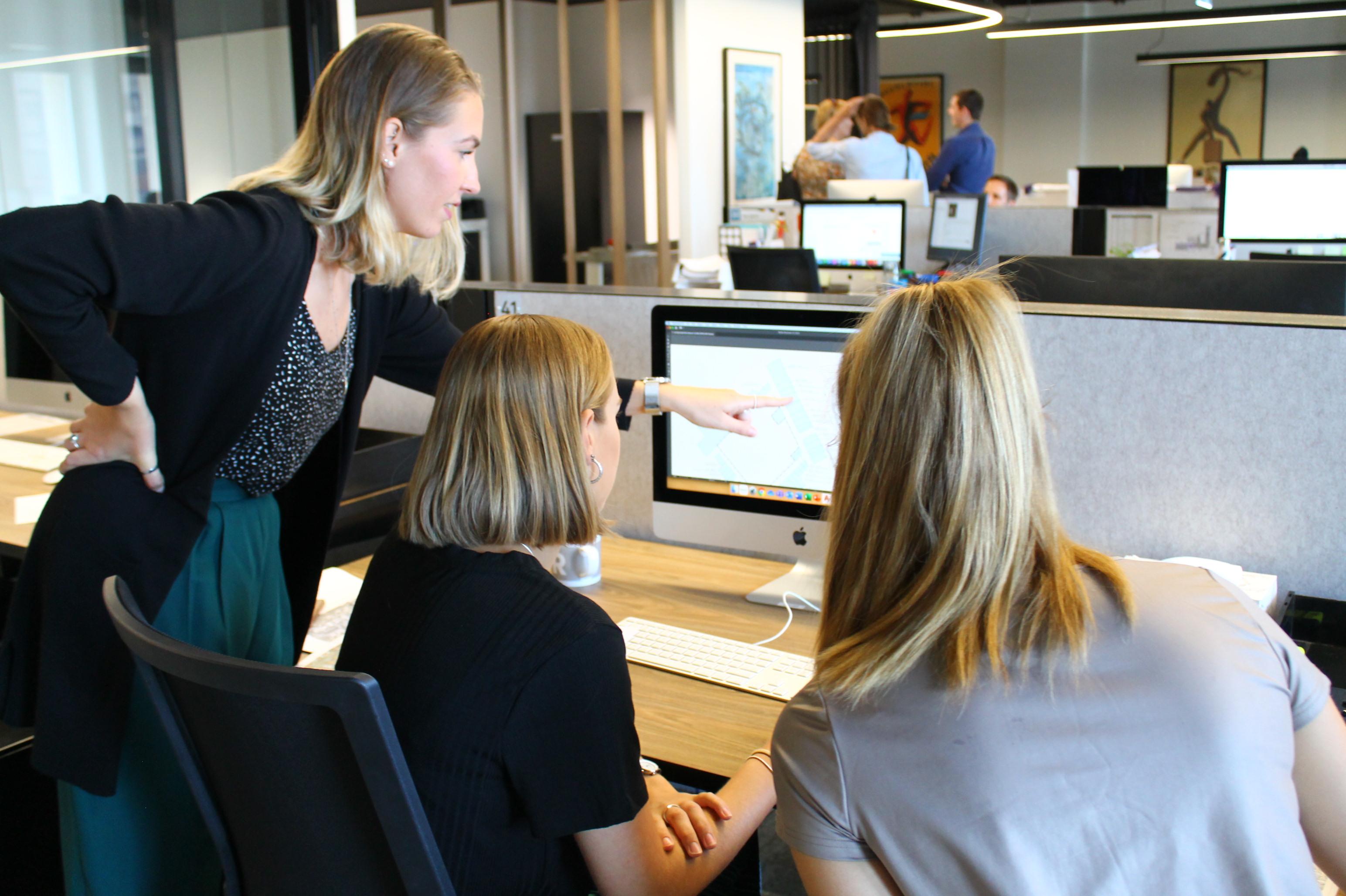 Consultants with students working together at element.