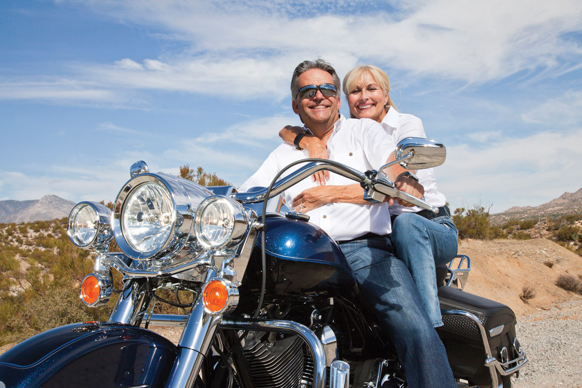 Senior couple enjoying a ride on their motorcycle