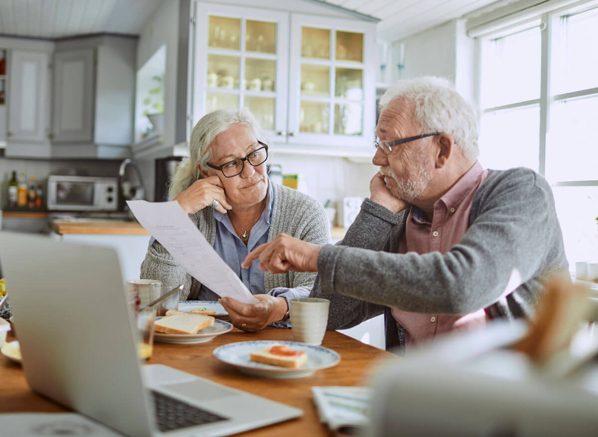 Senior couple discussing Medicare options