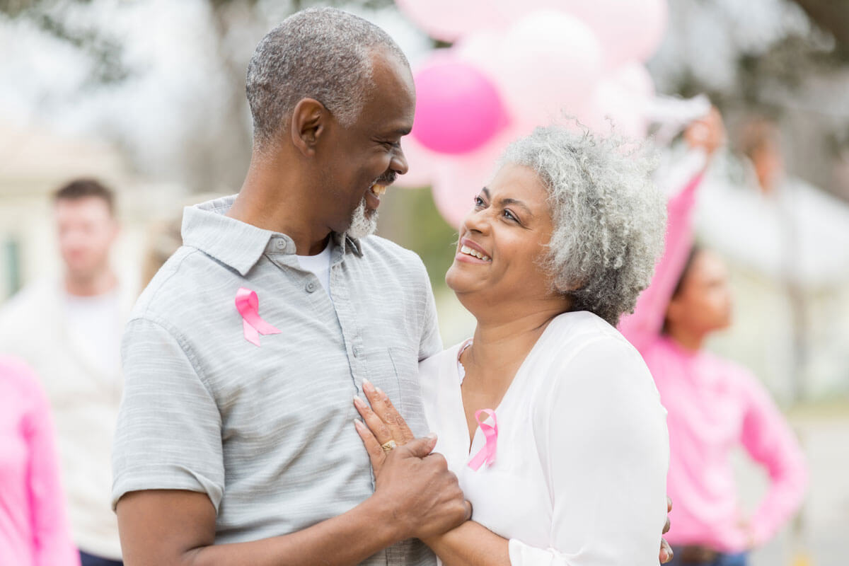 Husband and wife gazing lovingly at each other after breast cancer walk