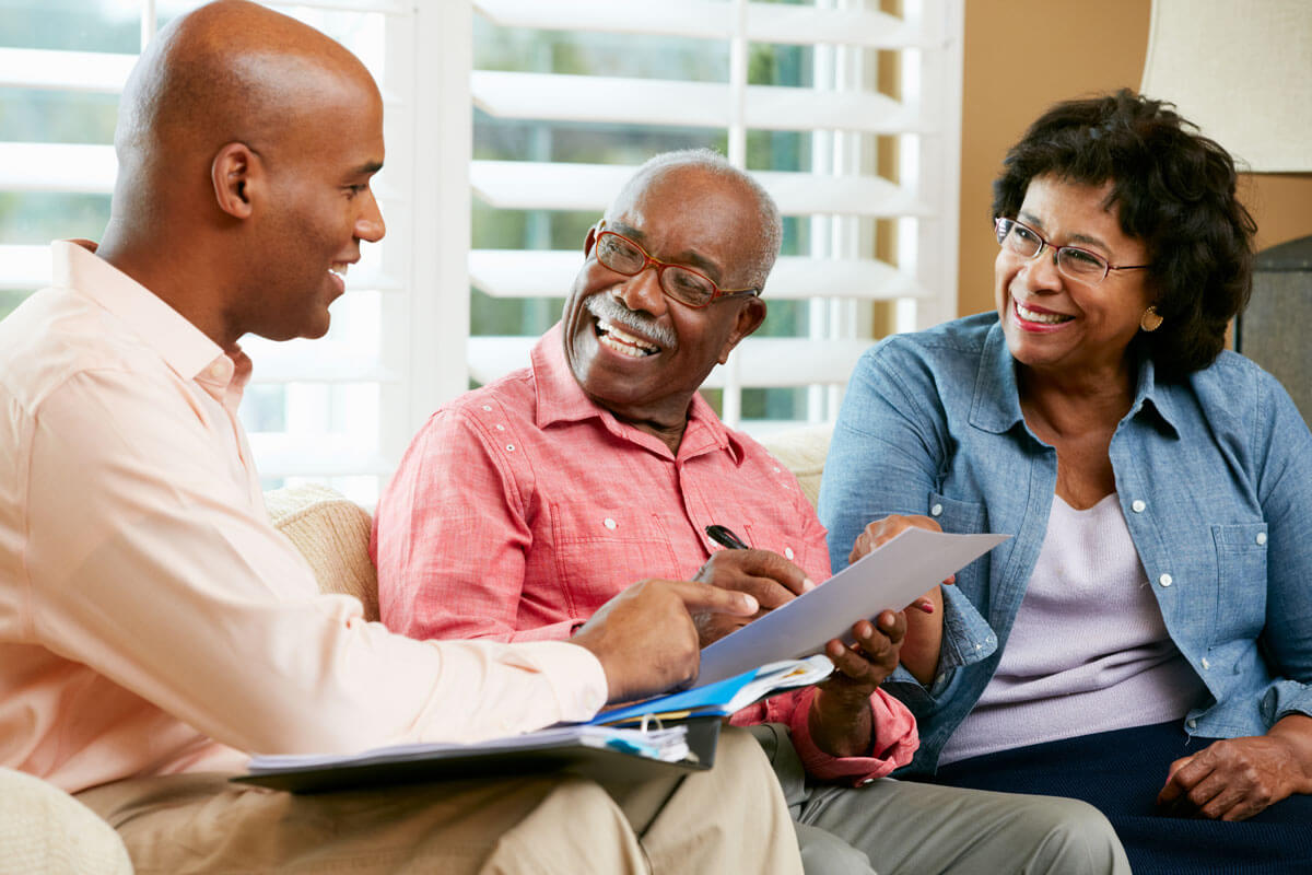 American Senior Benefits agent discussing insurance options with senior couple