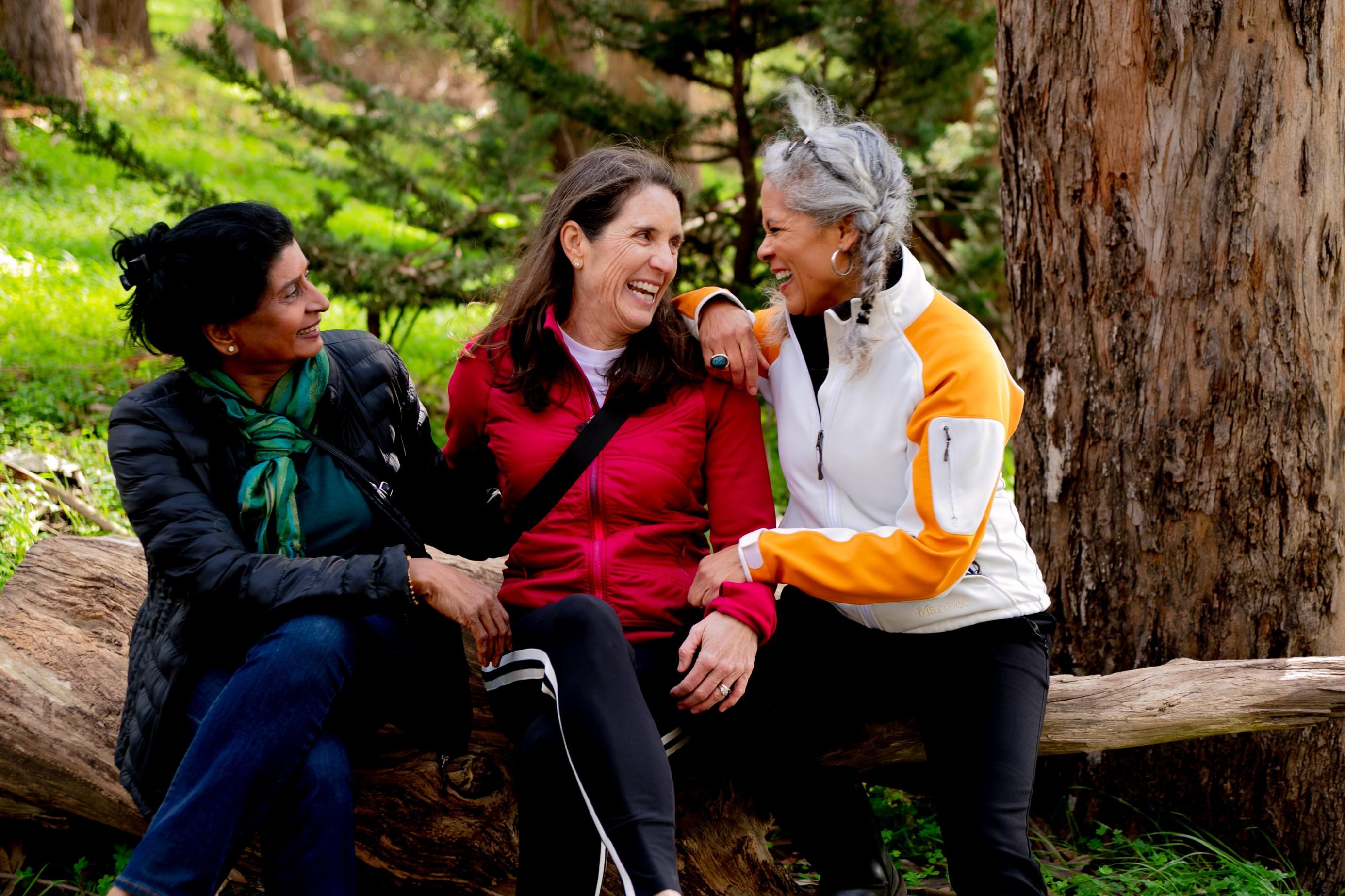 Ladies in conversation outdoors.