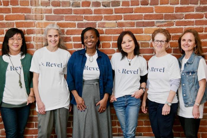 Women posing with Revel shirts