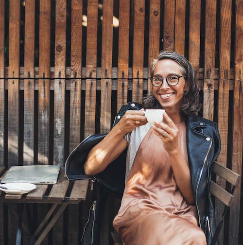 Lady drinking coffee.