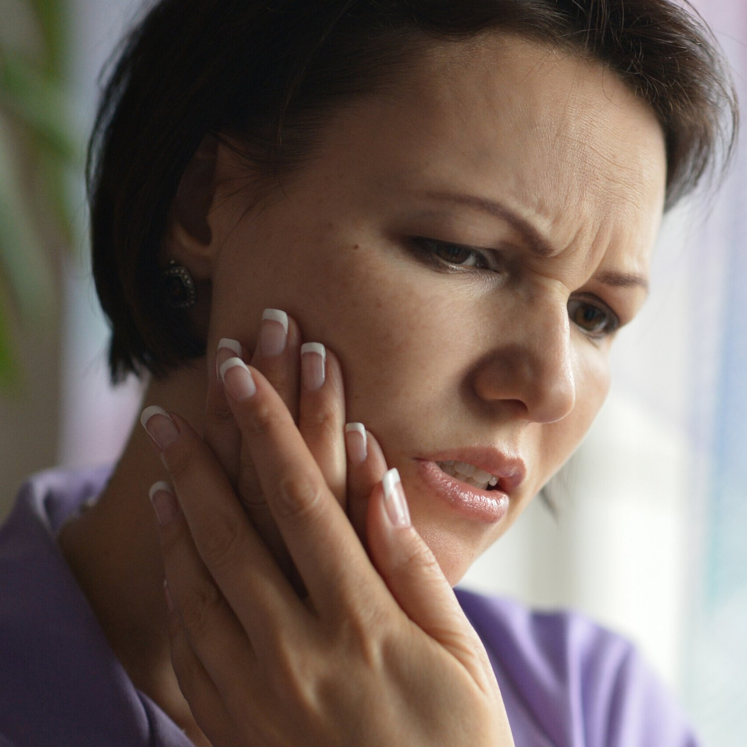 woman with dental pain -  Dentist in Peoria, AZ 85383