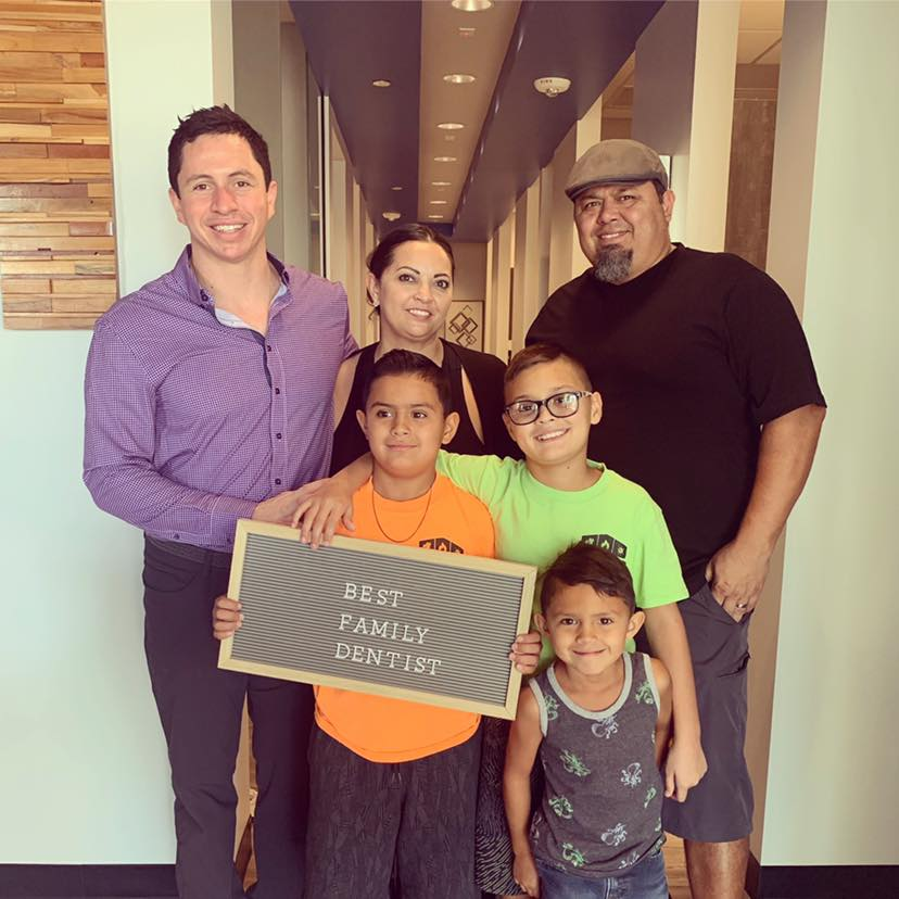 Dr. Ben Cooperman with a family at Dental Ben's in Peoria