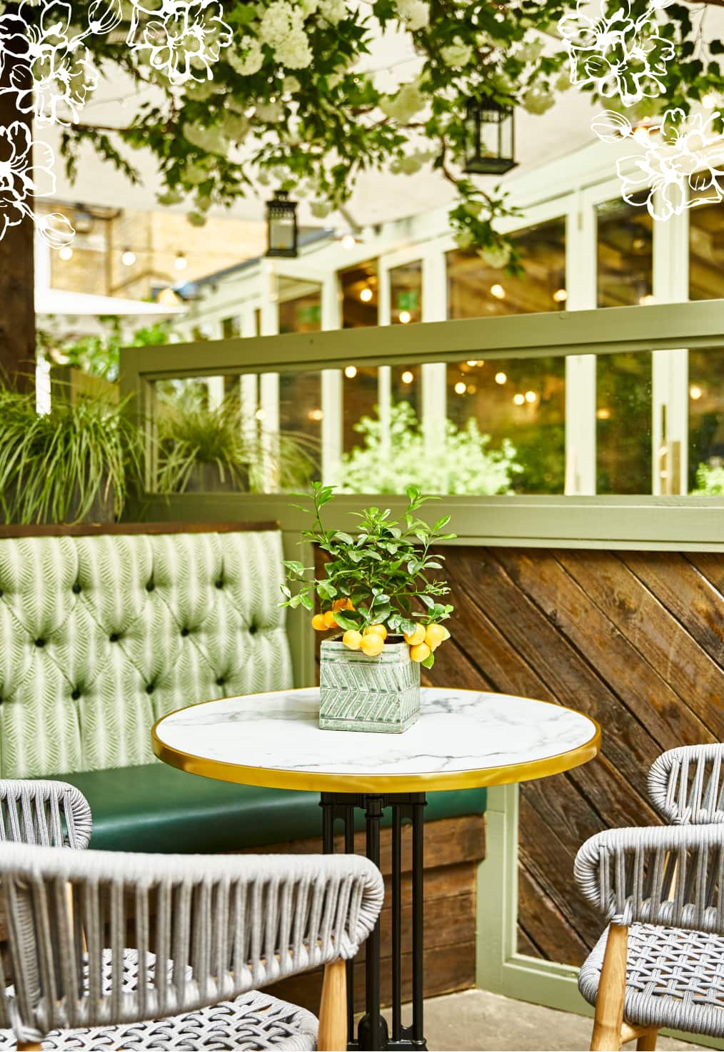 Stanley's outside courtyard table seating under a blossom umbrella